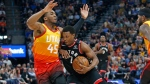 Utah Jazz guard Donovan Mitchell (45) guards against Toronto Raptors guard Kyle Lowry (7) in the first half during an NBA basketball game Monday, March 9, 2020, in Salt Lake City. THE CANADIAN PRESS/AP-Rick Bowmer
