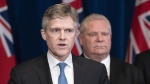 Ontario Premier Doug Ford listens as Finance Minister Rod Phillips speaks at a news conference at the Ontario Legislature in Toronto on Monday March 16, 2020. THE CANADIAN PRESS/Frank Gunn