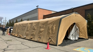 A tent is put up outside of the Daily Bread Food Bank on March 16, 2020. (Francis Gibbs/CTV News Toronto)