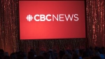 The CBC News logo is projected onto a screen during the CBC's annual upfront presentation at The Mattamy Athletic Centre in Toronto, Wednesday, May 29, 2019. The CBC is temporarily scrapping most of its local TV newscasts in response to the evolving COVID-19 crisis and putting the focus on coverage at CBC News Network. THE CANADIAN PRESS/Tijana Martin