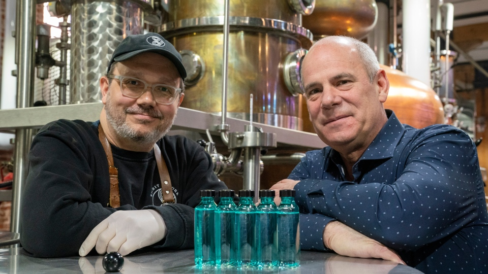 Spirit of York Head Distiller Mark Harrop (left) and founder Gerry Guitor pose with bottles of distillery-made hand sanitizer in Toronto on Wednesday March 18, 2020. With an outbreak of the novel coronavirus sweeping across Canada, Toronto-based Spirit of York Distillery Co. had an urge to do something to help, so they looked no further than the company's production facility. Instead of pumping out its usual vodkas and gins, the company decided to make something Canadians have been emptying from store shelves: hand sanitizer. THE CANADIAN PRESS/Frank Gunn