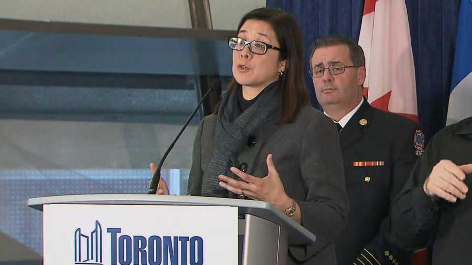 Toronto's chief medical officer of health Dr. Eileen de Villa speaks with Fire Chief Matthew Pegg at a news conference Wednesday March 18, 2020.