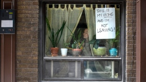 """""""Lee"""" is pictured at the window of her west Toronto apartment on Thursday March 19, 2020. THE CANADIAN PRESS/Chris Young"""