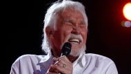 "In this June 9, 2012, file photo, Kenny Rogers performs at the 2012 CMA Music Festival in Nashville, Tenn. Actor-singer Kenny Rogers, the smooth, Grammy-winning balladeer who spanned jazz, folk, country and pop with such hits as ""Lucille,"" ""Lady"" and ""Islands in the Stream"" and embraced his persona as ""The Gambler"" on record and on TV died Friday night, March 20, 2020. He was 81. (Photo by Wade Payne/Invision/AP, File)"