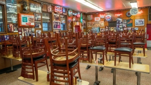 In this March 19, 2020 photo, chairs are stacked on the tables of Katz's Delicatessen on the Lower East Side of New York. The iconic eatery isonlyn open for take out and delivery orders due to the coronavirus outbreak. (AP Photo/Mary Altaffer)