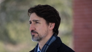 Prime Minister Justin Trudeau speaks at a press conference about COVID-19 in front of his residence at Rideau Cottage on the grounds of Rideau Hall in Ottawa, on Sunday, March 22, 2020. THE CANADIAN PRESS/Justin Tang