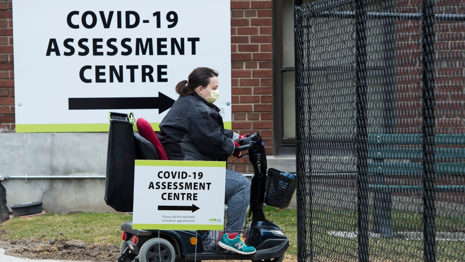 A woman arrives at the Covid-19 assessment centre at the Michael Garron Hospital in Toronto on Tuesday, March 24, 2020. THE CANADIAN PRESS/Nathan Denette