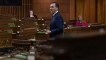 With a limited number of Members of Parliament on hand and spread out, Minister of Finance Bill Morneau responds to a question after tabling the governments COVID19 financial measures bill in the House of Commons Wednesday March 25, 2020 in Ottawa. THE CANADIAN PRESS/Adrian Wyld