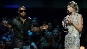 "In this Sept. 13, 2009 file photo, singer Kanye West takes the microphone from singer Taylor Swift as she accepts the ""Best Female Video"" award during the MTV Video Music Awards in New York. (AP Photo/Jason DeCrow, File)"