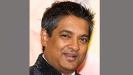 """This Aug. 4, 2014 file photo shows chef Floyd Cardoz at """"The Hundred-Foot Journey"""" premiere in New York. Cardoz, who competed on """"Top Chef,"""" won """"Top Chef Masters"""" and operated successful restaurants in both India and New York, has died of complications from the coronavirus, his company said Wednesday. He was 59. (Photo by Charles Sykes/Invision/AP, File)"""