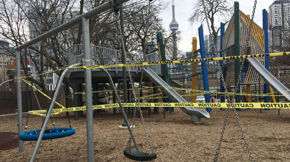 A playground at Grange Park in the city's downtown core is taped off following the city's closure of all facilities within Toronto parks. (Ken Enlow/ CP24)