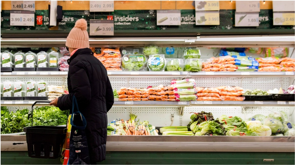 A women overlooks produce in a grocery store in Toronto on Friday, Nov. 30, 2018. THE CANADIAN PRESS/Nathan Denette