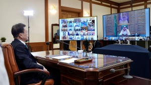 In this photo provided by South Korea Presidential Blue House via Yonhap News Agency, South Korean President Moon Jae-in attends G-20 virtual summit to discuss the coronavirus disease outbreak at the presidential Blue House in Seoul, South Korea, Thursday, March 26, 2020. (South Korea Presidential Blue House/Yonhap via AP)