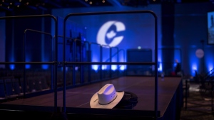 A cowboy hat is left inside an empty ballroom at the Conservative national convention in Halifax on Saturday, Aug. 25, 2018. THE CANADIAN PRESS/Darren Calabrese