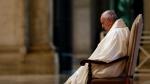 Pope Francis sits in at the entrance of St. Peter's Basilica, at the Vatican, Friday, March 27, 2020. (Yara Nardi/Pool Photo via AP)
