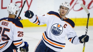Edmonton Oilers' Connor McDavid, right, celebrates his goal with teammate Darnell Nurse during first period NHL hockey action against the Calgary Flames in Calgary, Saturday, Feb. 1, 2020.THE CANADIAN PRESS/Jeff McIntosh