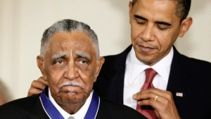 In this Aug. 12, 2009, file photo, President Barack Obama presents a 2009 Presidential Medal of Freedom to the Rev. Joseph E. Lowery n the East Room of the the White House in Washington. Lowery, a veteran civil rights leader who helped the Rev. Dr. Martin Luther King Jr. found the Southern Christian Leadership Conference and fought against racial discrimination, died Friday, March 27, 2020, a family statement said. He was 98. (AP Photo/J. Scott Applewhite, File)