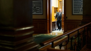 Ontario Premier Doug Ford walks from his office as he makes his way to a press briefing at the Ontario Legislature, in Toronto, Saturday, March 28, 2020. THE CANADIAN PRESS/Chris Young