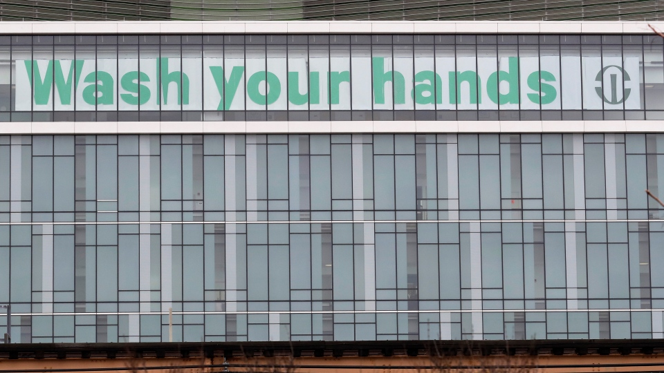 A sign is displayed at Rush University Medical Center in Chicago, Saturday, March 28, 2020. The new coronavirus cause mild or moderate symptoms for most people, but for some, especially older adults and people with existing health problems, it can cause more severe illness or death. (AP Photo/Nam Y. Huh)