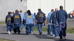 In this Feb. 26, 2013, file photo, inmates walk through the exercise yard at California State Prison Sacramento, near Folsom, Calif. (AP Photo/Rich Pedroncelli, File)