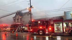 A fire truck is shown at the scene of a blaze at a rug store in Etobicoke on Sunday morning. (Shanelle Kaul)