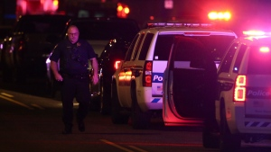 A Phoenix Police officer arrives on the scene of a shooting in Phoenix, Ariz., Sunday, March 29, 2020. At least three Phoenix police officers were shot Sunday night on the city's north side, authorities said. (AP Photo/Ross D. Franklin)
