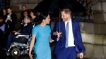 In this Thursday, March 5, 2020 file photo, Britain's Prince Harry and Meghan, the Duke and Duchess of Sussex arrive at the annual Endeavour Fund Awards in London. Prince Harry and his wife Meghan are ending their lives as senior members of Britain's royal family and starting an uncertain new chapter as international celebrities and charity patrons. In January the couple shocked Britain by announcing that they would step down from official duties, give up public funding, seek financial independence and swap the U.K. for North America. The split becomes official on March 31. (AP Photo/Kirsty Wigglesworth, file)