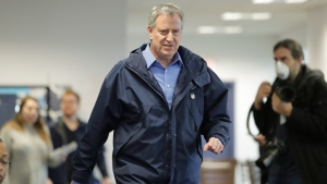 New York City Mayor Bill de Blasio arrives for a news conference at the USTA Indoor Training Center where a 350-bed temporary hospital will be built Tuesday, March 31, 2020, in New York. De Blasio said Tuesday that he expects the crisis to stretch through May. (AP Photo/Frank Franklin II)