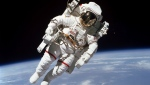 In this Feb. 7, 1984 photo made available by NASA, astronaut Bruce McCandless II, performs a spacewalk a few meters away from the cabin of the Earth-orbiting space shuttle Challenger, using a nitrogen-propelled Manned Maneuvering Unit.  (NASA via AP)