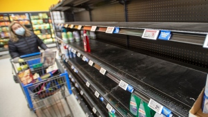 A shopper looks at empty cleaning supply shelves at a store, Thursday, March 19, 2020 in Laval, Que.THE CANADIAN PRESS/Ryan Remiorz