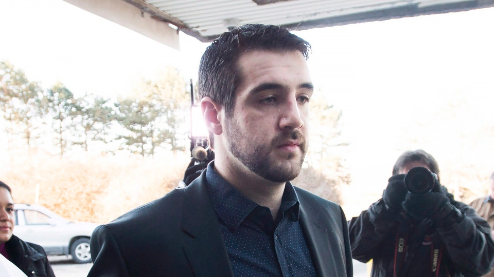 Marco Muzzo arrives with family at the court house for his sentencing hearing in Newmarket, Ont., on Tuesday, February 23, 2016. Muzzo, 29, pleaded guilty earlier this month to four counts of impaired driving causing death and two of impaired driving causing bodily harm. THE CANADIAN PRESS/Nathan Denette
