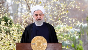 In this photo released on Friday March 20, 2020 by the official website of the office of the Iranian Presidency, President Hassan Rouhani delivers a message for the Iranian New Year, or Nowruz, in Tehran, Iran. Supreme Leader Ayatollah Ali Khamenei and President Hassan Rouhani in separate new year messages vowed to overcome the new coronavirus and increase economic growth. (Iranian Presidency Office via AP)