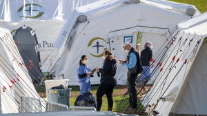 Medical personnel work at the Samaritan's Purse field hospital in New York's Central Park, Wednesday, April 1, 2020. The new coronavirus causes mild or moderate symptoms for most people, but for some, especially older adults and people with existing health problems, it can cause more severe illness or death. (AP Photo/Mary Altaffer)