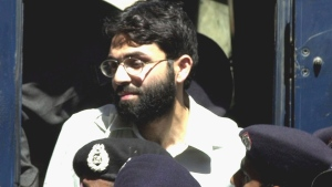 In this March 29, 2002, file photo, Ahmed Omar Saeed Sheikh, the alleged mastermind behind Wall Street Journal reporter Daniel Pearl's abduction, arrives at a court in Karachi, Pakistan. A Pakistani court on Thursday overturned the murder conviction of a British Pakistani man found guilty of the kidnapping and murder of Wall Street journalist Daniel Pearl. Instead, the court found Sheikh guilty of the lesser charge of kidnapping and sentenced him to seven years in jail. (AP Photo/Zia Mazhar, file)