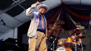 In this May 5, 2013, file photo, jazz pianist Ellis Marsalis, father of musicians Wynton Marsalis, Branford Marsalis, Delfeao Marsalis and Jason Marsalis, acknowledges the crowd after performing at the New Orleans Jazz and Heritage Festival in New Orleans. New Orleans Mayor LaToya Cantrell announced Wednesday, April 1, 2020, that Marsalis has died. He was 85. (AP Photo/Gerald Herbert, File)