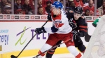 Canada's MacKenzie Entwistle, right, battles for the puck with Czech Republic's Filip Kral during first period IIHF world junior hockey championship action in Vancouver, on Saturday December 29, 2018. THE CANADIAN PRESS/Darryl Dyck