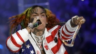 In this Sept. 21, 2018, file photo rapper Daniel Hernandez, known as Tekashi 6ix9ine, performs during the Philipp Plein women's 2019 Spring-Summer collection, unveiled during the Fashion Week in Milan, Italy. A New York judge has ordered the rapper immediately freed from a Manhattan federal jail because his asthma puts him in danger of the coronavirus. (AP Photo/Luca Bruno, File)