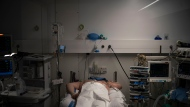 A COVID-19 patient undergoes treatment in one of the intensive care units (ICU) of the Germans Trias i Pujol hospital in Badalona, Barcelona province, Spain, Wednesday, April 1, 2020. The new coronavirus causes mild or moderate symptoms for most people, but for some, especially older adults and people with existing health problems, it can cause more severe illness or death. (AP Photo/Felipe Dana)