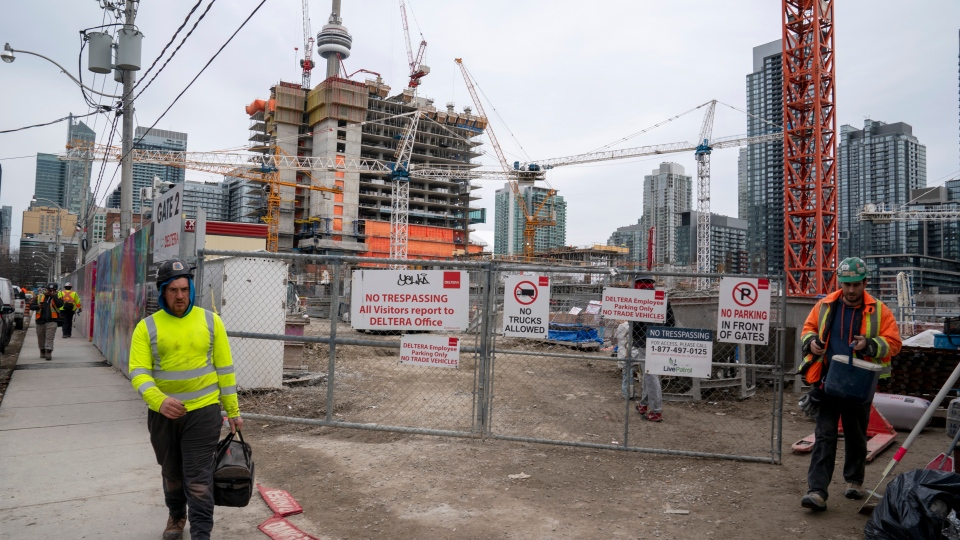 Construction workers at a site shift change in Toronto on Wednesday March 18, 2020. THE CANADIAN PRESS/Frank Gunn