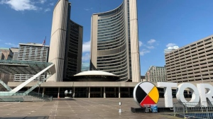 Amid the COVID1- pandemic, Nathan Phillips Square sits empty on what would normally be a bustling spring day Sunday March 29, 2020. (Joshua Freeman /CP24)