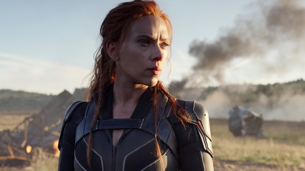 "This image released by Disney/Marvel Studios' shows Scarlett Johansson in a scene from ""Black Widow."" The Walt Disney Co. on Friday overhauled its release schedule, moving the dates of half a dozen Marvel movies. ""Black Widow,"" which had been set to kick off the summer movie season, will now open Nov. 6. (Marvel Studios/Disney via AP)"