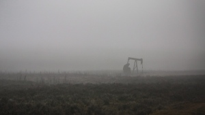 A pumpjack works at a well head on an oil and gas installation on a foggy day near Cremona, Alta., Saturday, Oct. 29, 2016. Canada's oil producers could only sit and watch as the price of their product plummeted to less than what it costs to buy a litre of soda in March, hit by the combined whammy of a COVID-19-induced drop in global demand, and a production war between Russia and Saudi Arabia that flooded the market with more oil it didn't need. THE CANADIAN PRESS/Jeff McIntosh