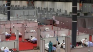 This photo taken on Thursday, April. 2, 2019 shows a general view of a temporary field hospital set at Ifema convention and exhibition in Madrid, Spain. Most of the 1,850 patients brought to the Ifema field hospital are not in serious conditions. In fact, 800 had been discharged by Thursday, although six had died since doors opened 12 days ago. The new coronavirus causes mild or moderate symptoms for most people, but for some, especially older adults and people with existing health problems, it can cause more severe illness or death. (AP Photo/Manu Fernandez)