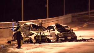 A collision reconstruction investigator is seen in front of two wrecked cars after a fatal crash in Etobicoke on April 4, 2020. (CP24)