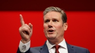 In this Monday, Sept. 23, 2019 file photo, Britain's Shadow Brexit Secretary Keir Starmer speaks on stage during the Labour Party Conference at the Brighton Centre in Brighton, England.  Britain's main opposition Labour Party has elected lawyer and lawmaker Keir Starmer as its new leader, after a contest thrown into turmoil by the coronavirus outbreak, it was announced on Saturday, April 4, 2020. (AP Photo/Kirsty Wigglesworth, file)
