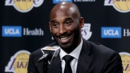 FILE - In this Dc. 18, 2017 file photo, former Los Angeles Laker Kobe Bryant talks during a news conference in Los Angeles. Bryant and fellow NBA greats Tim Duncan and Kevin Garnett headlined a nine-person group announced Saturday, April 4, 2020, as this year's class of enshrinees into the Naismith Memorial Basketball Hall of Fame. (AP Photo/Chris Carlson, File)
