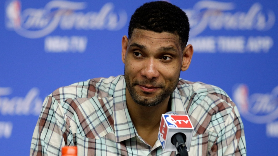 FILE - In this June 5, 2014 file photo, San Antonio Spurs forward Tim Duncan listens to a question during a news conference in San Antonio. Duncan, fellow NBA greats Kobe Bryant and Kevin Garnett headlined a nine-person group announced Saturday, April 4, 2020, as this year's class of enshrinees into the Naismith Memorial Basketball Hall of Fame. (AP Photo/Tony Gutierrez, File)