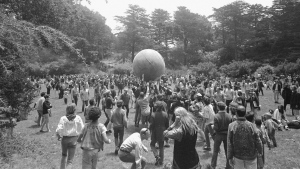 """In this June 21, 1967, file photo, people keep a large ball, painted to represent a world globe, in the air during a gathering at Golden Gate Park in San Francisco, to celebrate the summer solstice, Day 1 of the """"Summer of Love."""" Golden Gate Park turned 150 years old on Saturday, April 4, 2020, and the huge party to celebrate San Francisco's beloved treasure will, for the time being, take place online. (AP Photo/File)"""