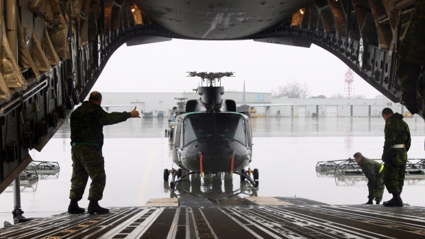 Canadian forces from Canadian Forces Base Borden, Squadron 400, load two CH-146 Griffon helicopters from Canadian Forces Base Bagotville, on a C-17 Globemaster at Canadian Forces Base Trenton on Sunday Nov. 17, 2013. THE CANADIAN PRESS/Lars Hagberg