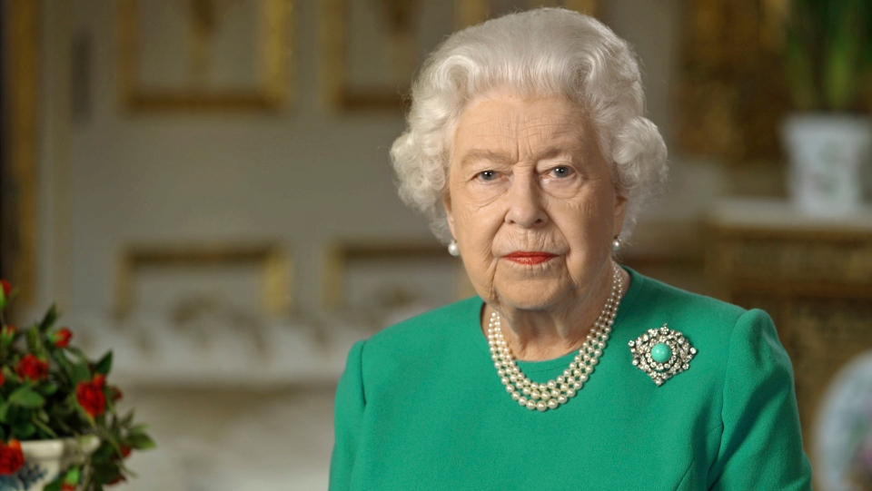 """In this image taken from video and made available by Buckingham Palace, Britain's Queen Elizabeth II addresses the nation and the Commonwealth from Windsor Castle, Windsor, England, Sunday April 5, 2020. Queen Elizabeth II made a rare address, calling on Britons to rise to the challenge of the coronavirus pandemic, to exercise self-discipline in """"an increasingly challenging time"""". (Buckingham Palace via AP)"""